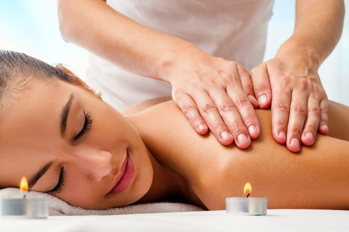 Attractive woman enjoying relaxing massage.